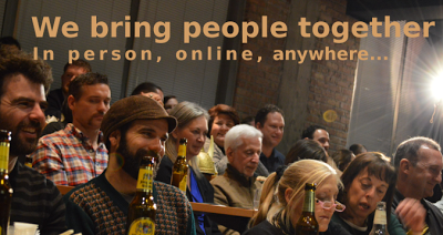 "Image of people in tiered seating with the words ""We Bring People Together"" appearing over the image."