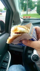 Hary Hawk holding a breakfast slider from White Castle, Rt 17 NJ